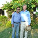 Nandan standing with Richard Dawkins in a garden